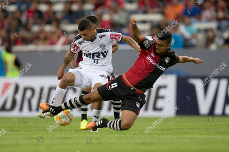 Stock Image of Luis Venegas, Carlos Carvalho Luis Venegas, right, of Mexico's Atlas fights for the ball with Carlos Carvalho, of Brazil's Atletico Mineiro during a Copa Libertadores soccer match in Guadalajara, Mexico