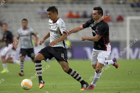 Luis Venegas, Luis Pedro Figueroa Luis Venegas, left, of Mexico's Atlas fights for the ball with Luis Pedro Figueroa of Chile's Colo-Colo during a Copa Libertadores soccer match in Guadalajara, Mexico