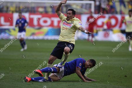Julio Cesar Dominguez, Oribe Peralta America's Oribe Peralta trips over Julio Cesar Dominguez of Cruz Azul during play in a Mexican soccer league match in Mexico City
