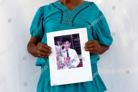 "Gregoria Mora C., Joel Mauro Galicia Mora Gregoria Mora C. holds up a photo of her missing son, Joel Mauro Galicia Mora, in Iguala, Mexico. Her son was 26 years old when he went missing on Sept. 25, 2014. The disappearance of the students from the Rural Normal School of Ayotzinapa on Sept. 26, 2014, gave hundreds of other families who had loved ones vanish the courage to come forward, many for the first time, to report the crimes. These, they said, were the ""other disappeared."" (AP Photo/Dario Lopez-Mills"