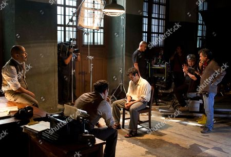 "Antonio Chavarrias Director Antonio Chavarrias, right, gives instructions on the set of the film ""El Elegido,"" or ""The Chosen,"" where actor Alfonso Herrera, who plays the character of Spaniard Ramon Mercader, sits in a chair during his interrogation in Mexico City. Told from the perspective of Mercader, the man who swung the deadly instrument that killed Leon Trotsky, the film recounts how the young communist, recruited and trained by the Soviet secret service, seduced an American woman who was close to the Soviet revolutionary-turned-exiled dissident to get to his target"