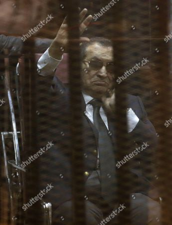 """Hosni Mubarak, Gamal Mubarak, Alaa Mubarak Former Egyptian President Hosni Mubarak, waves to his supporters as he attends with his two sons Gamal Mubarak, and Alaa Mubarak, the verdict in the corruption case dubbed by the Egyptian media as the """"presidential palaces"""" affair concerning charges that Mubarak and his two sons embezzled millions of dollars' worth of state funds over the course of a decade in a courtroom in Cairo, Egypt, . Egypt's deposed leader Hosni Mubarak and his two sons were sentenced Saturday to three years in prison and a fine in a retrial on corruption charges they faced earlier. It wasn't immediately clear whether it will include time he's already served since his country's 2011 revolt"""