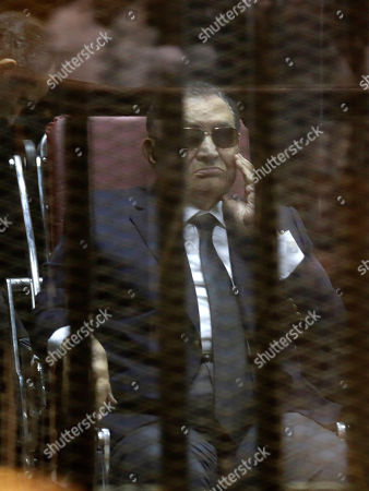 """Hosni Mubarak Former Egyptian President Hosni Mubarak, attends with his two sons Gamal Mubarak, and Alaa Mubarak, the verdict in the corruption case dubbed by the Egyptian media as the """"presidential palaces"""" affair concerning charges that Mubarak and his two sons embezzled millions of dollars' worth of state funds over the course of a decade in a courtroom in Cairo, Egypt, . Egypt's deposed leader Hosni Mubarak and his two sons were sentenced Saturday to three years in prison and a fine in a retrial on corruption charges they faced earlier. It wasn't immediately clear whether it will include time he's already served since his country's 2011 revolt"""