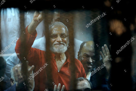 Mohammed Badie Muslim Brotherhood spiritual leader, Mohammed Badie wearing a red jumpsuit that designates he has been sentenced to death, waves from a defendants cage in a makeshift courtroom at the national police academy, eastern Cairo, Egypt, . An Egyptian court on Saturday sentenced ousted President Mohammed Morsi and over 100 others to death including Badie, as well as one of the Arab world's best known Islamic scholars, the Qatar-based Youssef al-Qaradawi. Badie was sentenced to death in another case in April