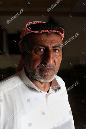 Sheikh Mohammed Abdullah Ibrahim Aatiyah, poses for a portrait. His wife was assassinated by the Islamic State group who then handed out the death certificate to Aatiyah in Mosul, Iraq
