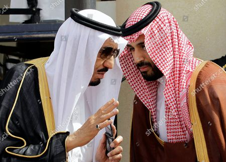 Then Crown Prince Salman bin Abdul-Aziz Al Saud, left, speaks with his son Prince Mohammed as they wait for Gulf Arab leaders ahead of the opening of Gulf Cooperation Council, also known as GCC summit, in Riyadh, Saudi Arabia. Saudi Arabia's King Salman on removed his half-brother from the post of crown prince and named his nephew, the country's Interior Minister, in his place. The post of crown prince secures Prince Mohammed bin Nayef as the most likely successor to King Salman