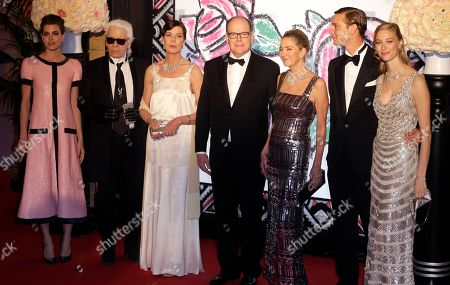 Prince Albert II of Monaco, right, Princess Caroline of Hanover, second right, her daughter Charlotte Casiraghi, left and son Pierre Casiraghi, second right, his girlfriend countess Beatrice Boromeo, right, and German fashion designer Karl Lagerfeld pose for photographers as they arrive at the Rose Ball in Monaco, . The Rose Ball is the traditional annual charity event in the Principality of Monaco