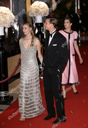 Pierre Casiraghi with his girlfriend countess Beatrice Boromeo, and his sister Charlotte Casiraghi, right, arrive at the Rose Ball in Monaco, . The Rose Ball is the traditional annual charity event in the Principality of Monaco