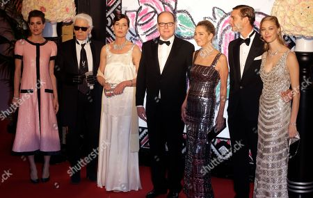 Left to right, Charlotte Casiraghi, German designer Karl Lagerfeld, Princess Caroline of Hanover, Prince Albert II of Monaco, mother of Beatrice Boromeo, Paola Marzotto, Pierre Casiraghi with his girlfriend countess Beatrice Boromeo, pose for photographers as they arrive at the Rose Ball in Monaco, . The Rose Ball is the traditional annual charity event in the Principality of Monaco