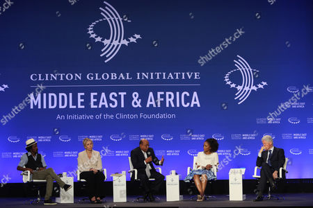 Former U.S President Bill Clinton, right, listens during a plenary session Connecting People for Growth at the Clinton Global Initiative Middle East & Africa meeting in Marrakech, Morocco, . From left to right are K'naan Warsame, Nezha Hayat, Member of the Management Board, SociÈtÈ GÈnÈrale Maroc, Mo Ibrahim, Founder and Chair, Mo Ibrahim Foundation, Phuti Mahanyele, Chief Executive Officer, Shanduka Group (Pty) Ltd and Former President Bill Clinton