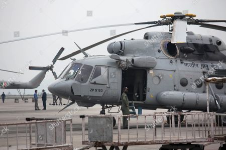 An Indian army helicopter is parked on the tarmac of the Kathmandu international airport the day after a massive earthquake devastated the region, in Kathmandu, Nepal, . Indian air force planes landed Sunday with 43 tons of relief material, including tents and food, and nearly 200 rescuers, India's External Affairs Ministry spokesman Vikas Swarup said. The planes were returning to New Delhi with Indian nationals stranded in Kathmandu