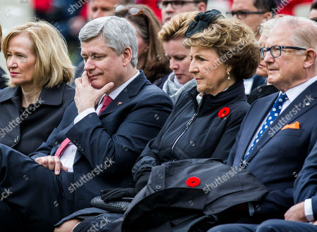 Canadian Prime Minister Stephen Harper, second left, his wife Laureen Harper, left, Netherlands' Princess Margriet, second right, and her husband Pieter van Vollenhoven, right, during memorial ceremonies in honor of Canadian soldiers who died during the liberation of the Netherlands in 1945 at the Canadian War Cemetery in Holten, east Netherlands, . Harper is in the Netherlands to mark the 70th anniversary of the Liberation of the Netherlands