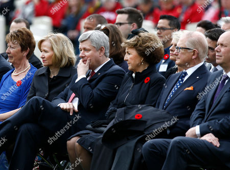 Canadian Prime Minister Stephen Harper, center, his wife Laureen Harper, second left, Netherlands' Princess Margriet, second right, and her husband Pieter van Vollenhoven, right, attend memorial ceremonies in honor of Canadian soldiers who died during the liberation of the Netherlands in 1945 at the Canadian War Cemetery in Holten, east Netherlands, . Harper is in the Netherlands to mark the 70th anniversary of the Liberation of the Netherlands