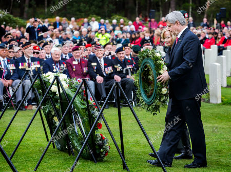 Canadian Prime Minister Stephen Harper, right, and his wife Laureen Harper lay a wreath during memorial ceremonies in honor of Canadian soldiers who died during the liberation of the Netherlands in 1945 at the Canadian War Cemetery in Holten, east Netherlands, . Harper is in the Netherlands to mark the 70th anniversary of the Liberation of the Netherlands