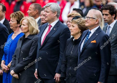 Canadian Prime Minister Stephen Harper, center, his wife Laureen Harper, second left, Netherlands' Princess Margriet, second right, and her husband Pieter van Vollenhoven, right, during memorial ceremonies in honor of Canadian soldiers who died during the liberation of the Netherlands in 1945 at the Canadian War Cemetery in Holten, east Netherlands, . Harper is in the Netherlands to mark the 70th anniversary of the Liberation of the Netherlands