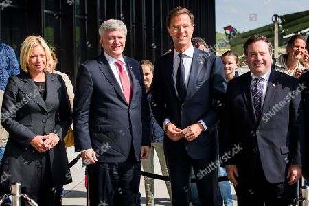 From left, Dutch Defense Minister Jeanine Hennis-Plasschaert, Canadian Prime Minister Stephen Harper, Dutch Prime Minister Mark Rutte and Canadian Defence Minister Jason Kenney pose for a photo at the National Military Museum in Soest, central Netherlands, . Rutte and Harper are meeting to kick off a week of celebrations and remembrances to mark the 70th anniversary of the liberation of the Netherlands at the end of World War II