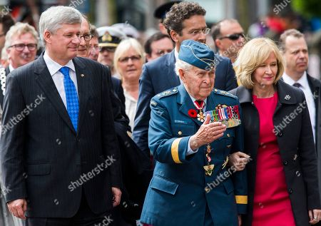 Stock Picture of Canadian Prime Minister Stephen Harper, left, arrives with his wife Laureen Harper, right, and Major-General Richard Rohmer, center, at a parade in Wageningen, Netherlands, marking the 70th anniversary of the surrender of Nazi forces on May 5, 1945. A week of celebrations and remembrances marks the 70th anniversary of the liberation of the Netherlands at the end of World War II