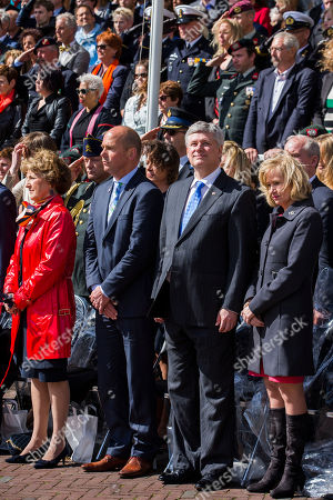 Canadian Prime Minister Stephen Harper, second right, his wife Laureen Harper, right, and Netherlands' Princess Margriet, left, observe a moment of silence during a parade in Wageningen, Netherlands, marking the 70th anniversary of the surrender of Nazi forces on May 5, 1945. A week of celebrations and remembrances marks the 70th anniversary of the liberation of the Netherlands at the end of World War II