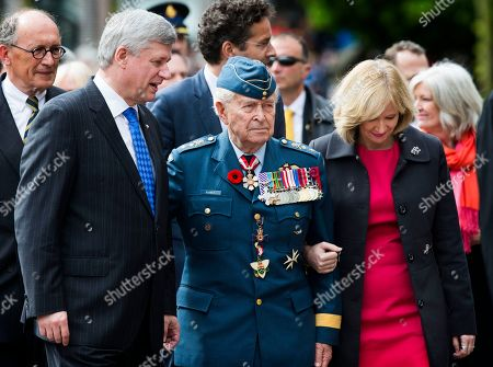 Canadian Prime Minister Stephen Harper, left, arrives with his wife Laureen Harper, right, and Major-General Richard Rohmer, center, at a parade in Wageningen, Netherlands, marking the 70th anniversary of the surrender of Nazi forces on May 5, 1945. A week of celebrations and remembrances marks the 70th anniversary of the liberation of the Netherlands at the end of World War II