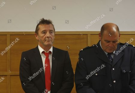 Stock Picture of Phil Rudd AC/DC drummer Phil Rudd, left, stands in the dock at a court in Tauranga, New Zealand, . Rudd pleaded guilty to a charge of threatening to kill a man who used to work for him. He also pleaded guilty to possessing methamphetamine and marijuana
