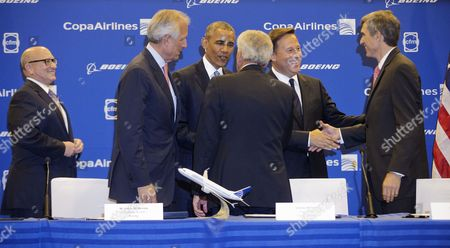 Stock Photo of Barack Obama, Juan Carlos Varela, David Joyce, Jim McNerney, Stanley Motta, Pedro Heilbron President Barack Obama and Panamanian President Juan Carlos Varela, right, greet, from left, GE Aviation President and CEO David Joyce, Boeing Chairman and CEO Jim McNerney, Copa Chairman Stanley Motta, and Copa CEO Pedro Heilbron, after they signed an airplane order between Copa Airlines and Boeing, announcing plans for the Panamanian airlines to purchase 61 of the US airplane giant 737 aircraft, during a ceremony in Panama City, Panama