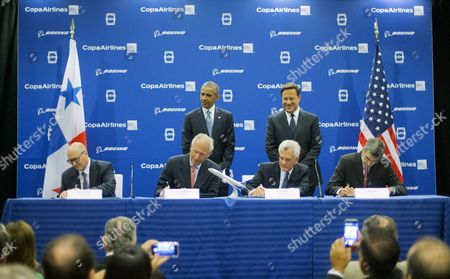 Barack Obama, Juan Carlos Varela, David Joyce, Jim McNerney, Stanley Motta, Pedro Heilbron President Barack Obama and Panamanian President Juan Carlos Varela attend the signing airplane order between Copa Airlines and Boeing, announcing plans for the Panamanian airlines to purchase 61 of the US airplane giant 737 aircraft, during a ceremony in Panama City, Panama. Signing the orders are from left to right, GE Aviation President and CEO David Joyce, Boeing Chairman and CEO Jim McNerney, Copa Chairman Stanley Motta, and Copa CEO Pedro Heilbron