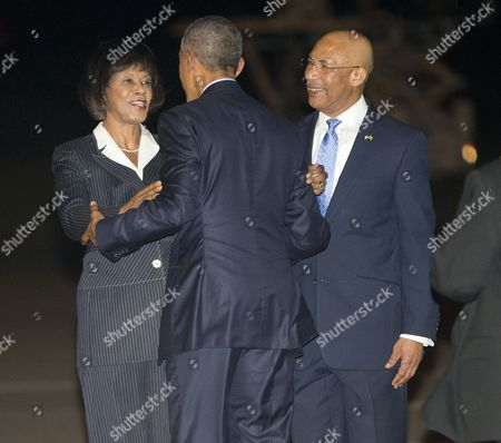 Barack Obama, Portia Simpson-Miller, Patrick Allen U.S. President Barack Obama, center, is greeted by with Prime Minister Portia Simpson-Miller of Jamaica, left, and Patrick Allen, Governor General of Jamaica, right, on the tarmac during his arrival on Air Force One, at Norman Manley International Airport in Palisadoes, Jamaica
