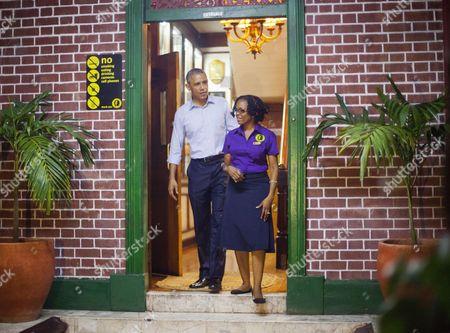 Barack Obama, Natasha Clark U.S. President Barack Obama walks outside with tour guide Natasha Clark, during his unannounced visit to the Bob Marley Museum in Kingston, Jamaica
