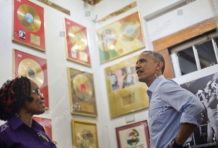 Barack Obama, Natasha Clark U.S. President Barack Obama, right, visits the Bob Marley Museum with tour guide Natasha Clark, left, in Kingston, Jamaica
