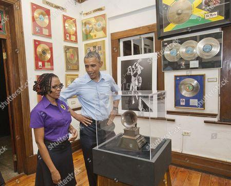 Barack Obama, Natasha Clark U.S. President Barack Obama visits the Bob Marley Museum with tour guide Natasha Clark. in Kingston, Jamaica