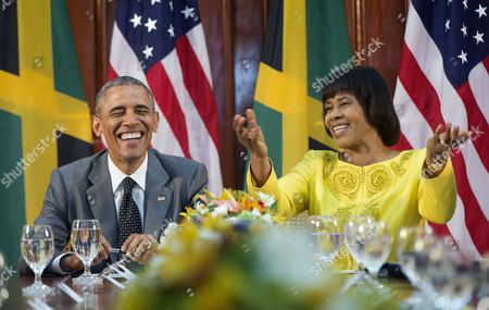 Barack Obama, Portia Simpson-Miller President Barack Obama smiles as he reacts to comments made by Jamaican Prime Minister Portia Simpson-Miller, right, during their bilateral meeting at the Jamaica House, in Kingston, Jamaica