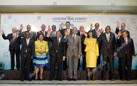 Barack Obama, Portia Simpson-Miller US President Barack Obama, center, and Jamaican Prime Minister Portia Simpson-Miller, right, are joined by Caribbean Community (CARICOM) leaders for a group photo during the start of their summit, in Kingston, Jamaica