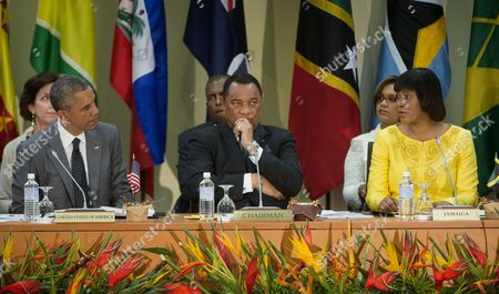 Barack Obama, Portia Simpson-Miller, Perry G. Christie President Barack Obama listens to opening remarks by Jamaican Prime Minister Portia Simpson-Miller, right, at start the summit with Caribbean Community (CARICOM) leaders, in Kingston, Jamaica. Also listening is Prime Minister of Bahamas Perry G. Christie, center. The president said Thursday that he soon decide whether to remove Cuba from the U.S. list of state sponsors of terrorism now that the State Department has finished a review on the question as part of the move to reopen diplomatic relations with the island nation