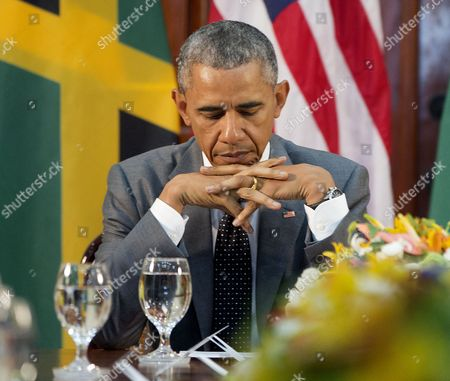 Barack Obama President Barack Obama looks down at his notes during a bilateral meeting with Jamaican Prime Minister Portia Simpson-Miller at the Jamaica House, in Kingston, Jamaica