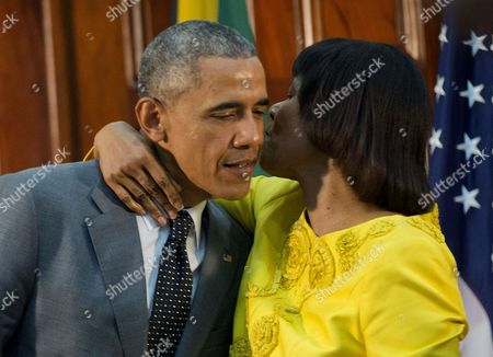 Barack Obama, Portia Simpson-Miller Jamaican Prime Minister Portia Simpson-Miller hugs President Barack Obama following the conclusion of their bilateral meeting at the Jamaica House, in Kingston, Jamaica