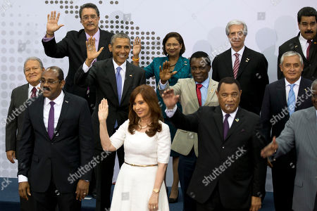 Heads of State attending the VII Summit of the Americas, pose for the official group photo, in Panama City, Panama, . Pictured are; bottom row from left, Antigua and Barbuda's Prime Minister Gaston A. Browne, Argentina's President Cristina Fernandez, Bahamas Prime Minister Perry Gladstone Christie. Middle row from left, El Salvador's President Salvador Sanchez Ceren, President Barack Obama, Grenada's Prime Minister Keith Mitchell, Guatemala's President Otto Perez Molina. Top row from left, Saint Lucia's Prime Minister Kenny Anthony, Trinidad and Tobago's Prime Minister Kamla Persad-Bissessar, Uruguay's President Tabare Vazquez and Venezuela's President Nicolas Maduro