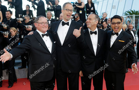 """Ronnie del Carmen Director Ronnie del Carmen, right, poses for a photo with, from left: chief creative officer at Pixar John Lasseter, director Pete Docter and producer Jonas Rivera upon their arrival for the screening of the film """"Inside Out"""" at the 68th international film festival, Cannes, southern France. The Filipino-American co-director of the highly successful animated movie """"Inside Out"""" said that it's a dream come true for him to share with Filipinos a film he helped create"""