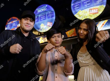 "Stock Picture of Paul Soriano, Buboy Villar, Alessandra De Rossi Film director Paul Soriano, left, actors, Buboy Villar, center, and Alessandra De Rossi, show their stance as they pose before the premiere of ""Kid Kulafu,"" a film about Filipino boxing champion Manny Pacquiao at cinemas at Rockwell Shopping complex in the financial district of Makati city, east of Manila, Philippines Tuesday, April 14, 2015. As a dirt-poor rookie boxer in the southern Philippines, Pacquiao started his phenomenal rise to global fame not as the Pacman, as he is sometimes called, but as ""Kid Kulafu."" The film opened Wednesday in more than 70 theaters across the Philippines, ahead of Pacquiao's May 2 megafight with Floyd Mayweather and will be shown in some U.S. and Canadian theaters beginning April 24"