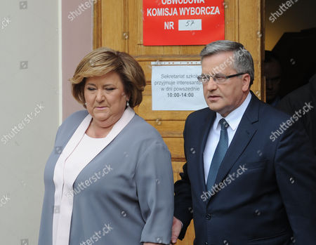 Bronislaw Komorowski, Anna Komorowska Polish President Bronislaw Komorowski and wife Anna leave a voting station after balloting in the first round of the presidential election in Warsaw, Poland, . The Poles are voting for president in nationwide balloting that is expected to see incumbent Komorowski, re-elected, but not in the first voting round