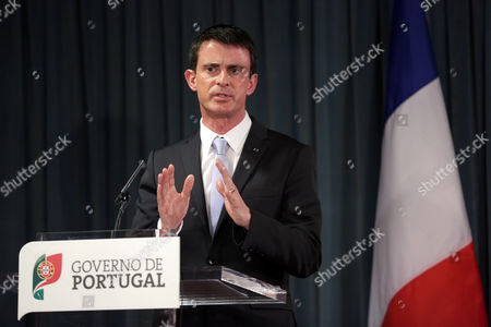 Manuel Valls, Pedro Passos Coelho France's Prime Minister Manuel Valls gestures during a joint news conference following his meeting with his Portuguese counterpart Pedro Passos Coelho at Lisbon's Sao Bento palace, the Portuguese premier's official residence