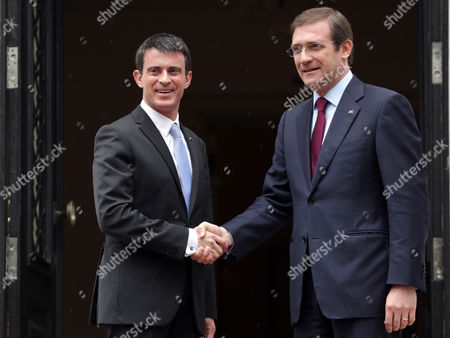 Manuel Valls, Pedro Passos Coelho France's Prime Minister Manuel Valls, left, and his Portuguese counterpart Pedro Passos Coelho pose for photographers before their meeting at Lisbon's Sao Bento palace, the Portuguese premier's official residence