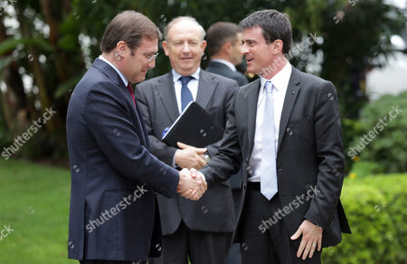 Manuel Valls, Pedro Passos Coelho France's Prime Minister Manuel Valls, right, shakes hands with his Portuguese counterpart Pedro Passos Coelho upon arriving at Lisbon's Sao Bento palace, the Portuguese premier's official residence