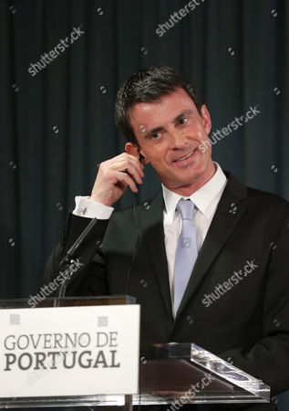 Manuel Valls France's Prime Minister, Manuel Valls, removes his earphone during a joint news conference following his meeting with his Portuguese counterpart Pedro Passos Coelho at Lisbon's Sao Bento palace, the Portuguese premier's official residence
