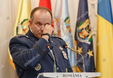 NATO's Supreme Allied Commander Europe, General Philip Breedlove wipes his eye during a media briefing in Bucharest, Romania, . Breedlove said a convoy of U.S. troops crossing eastern Europe is a way of reassuring allies of the military alliance's support and of practicing little-used skills