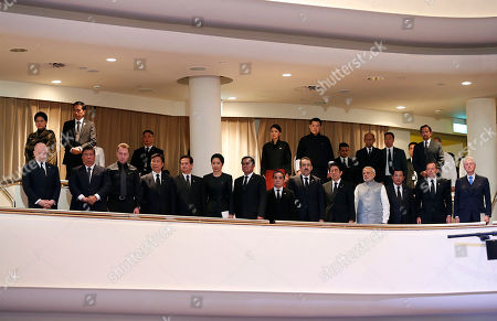 World leaders seen from left to right in the front row, British First Secretary of State William Hague, Philippine's Senate President Franklin Drilon, Russian First Deputy Prime Minister Igor Shuvalov, China's Vice President Li Yuanchao, Vietnamese Prime Minister Nguyen Tan Dung, Naraporn Chan-ocha and her husband Prayuth Chan-ocha, Prime Minister of Thailand, Lao Prime Minister Thongsing Thammavong, Kazakhstan's Prime Minister Karim Massimov, Japan's Prime Minister Shinzo Abe, Indian Prime Minister Narendra Modi, Cambodian Prime Minister Hun Sen, Australia's Prime Minister Tony Abbott, and Former U.S. President Bill Clinton, and in the back row, seen from left to right, Indonesian President Joko Widodo with his wife Iriana, Bhutan's Queen Jetsun Pem, and King Jigme Khesar Namgyel Wangchuck, and Sultan of Brunei Hassanal Bolkiah, top right, observe a moment of silence during a state funeral of the late Lee Kuan Yew, held at the University Cultural Center, in Singapore. During a week of national mourning that began Monday after Lee's death at age 91, some 450,000 people queued for hours for a glimpse of Lee's coffin at Parliament House. A million people visited tribute sites at community centers across the island and leaders and dignitaries from more than two dozen countries attended the state funeral