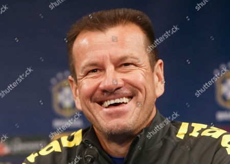 Brazil's soccer team coach Carlos Dunga, smiles as he speaks to the media during a press conference prior to a training session of the Brazil national soccer team at Stade de France stadium in Saint Denis, outside Paris