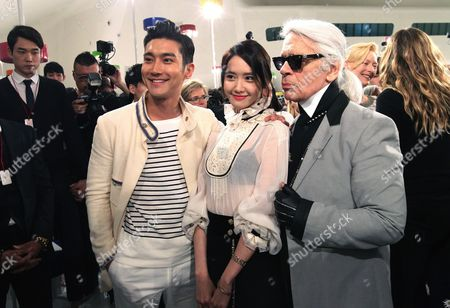 Karl Lagerfeld, Choi Si-Won, Im Yoona German fashion designer Karl Lagerfeld, right, poses with South Korean actor and singer Choi Si-Won and actress and singer Im Yoona, center, after the presentation of his 2015-2016 Chanel cruise collection at the Dongdaemun Design Plaza in Seoul, South Korea