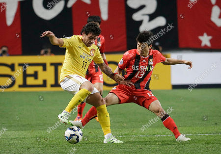 Goulart Pereira, Go Yo-han China's Guangzhou Evergrande's Goulart Pereira, left, fights for the ball against South Korea's FC Seoul's Go Yo-han during their Group H soccer match in the Asian Champions League at Seoul World Cup Stadium in Seoul, South Korea, . The match ended in a 0-0 draw