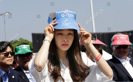 Stock Image of Kim Yu-na Former Olympic figure-skating gold medalist Kim Yu-na adjusts her cap as she attends a ceremony to celebrate the 1,000-day countdown to the 2018 Winter Olympics at Olympic Park in Seoul, South Korea
