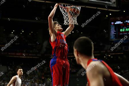 Andrei Kirilenko CSKA Moscow's Andrei Kirilenko, top, dunks, during the Euroleague Final Four semifinal basketball match between CSKA Moscow and Olympiacos in Madrid, Spain